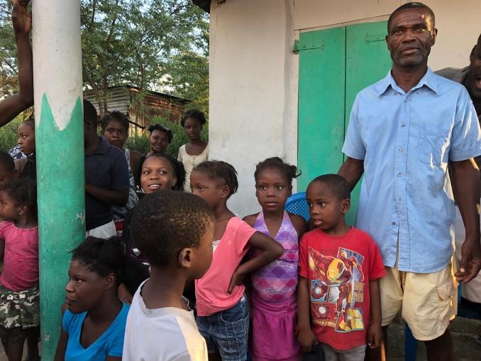 A Haitian family in the neighborhood.